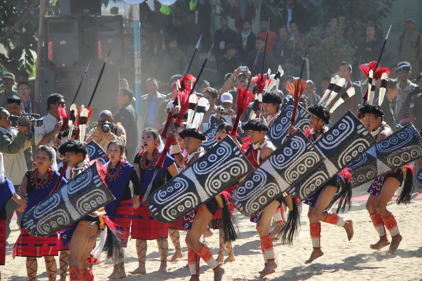 Hornbill Festival of Nagaland Tour Package – Famous Cultural Festival of Northeast India  Hornbill Festival of Nagaland Tour Package: Overview Nagaland is famous land of festivals which is located at Myanmar Border in northeast India.  It is a home to diverse indigenous tribes with festivals and markets celebrating the different tribal culture.  Holiday Travel India is one of the best Travel agency brought to you Hornbill Festival of Nagaland Tour Package. For Seeing its grand success and achievement at attracting tourists from far and wide from across India and abroad.  In this package we offer sightseeing with tribes at Hornbill festival and explore famous games, cuisines and dance of tribes. Grab the chance and visit Kohima and explore its rich culture tradition and much more with us at pocket friendly rates.   What is Unique in Hornbill Festival of Nagaland Tour Package and Why? Hornbill Festival of Nagaland Tour Package is unique because we provide chance to explore rich culture, tradition, festivals and be a part of Hornbill Festival which is most important festival of Nagaland with proper guideline.  Well arrange hotel/camp with night bornfire and offer to visit other famous excursion of Kohima.    Hornbill Festival of Nagaland Tour Package: Highlights One of those rare villages counted as green village of India:  Khonoma Village Eye- catching of Kohima: Japfu Peak Historical landmark dedicated to 10,000 brave soldiers Ancient village of Kohima: Bara Basti Shows fascinating arts and artifacts in Kohima: State Museum Conservation of Several Rare species in kohima: Intanki Wildlife Sanctuary