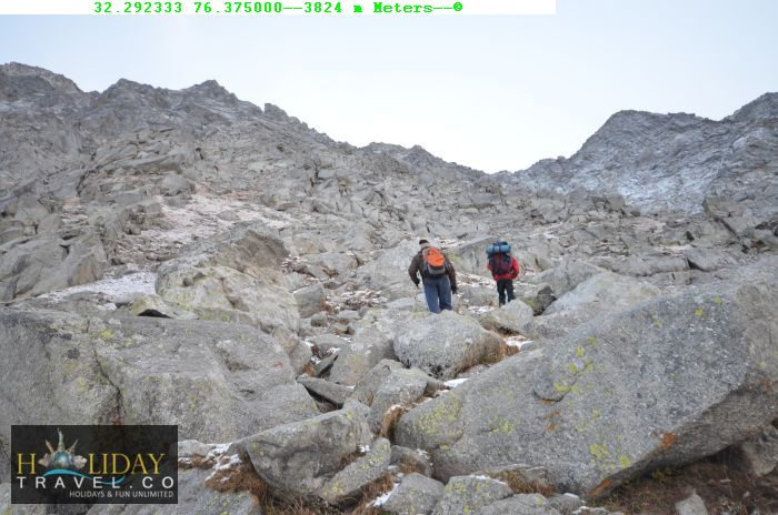 Indrahar-pass-Trek-Guide-At3824Meters-TrekkersFacing-SteepWall-To-Navigate-IndrahaarPass