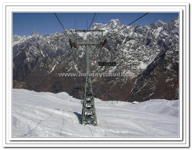 Auli - Cable cars in Action - The Only Link with Joshimath. The Hotel Clifftop survives due to these cable cards, even a cigrette pack comes through these cable cars